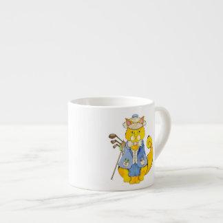 Taza del café express del golfista