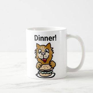 Taza del dibujo animado del gato de la cena
