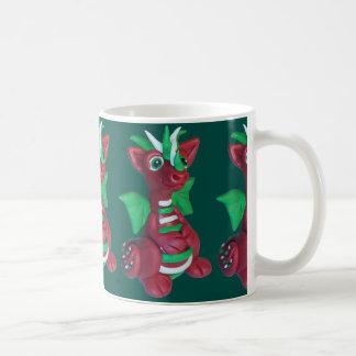 Taza del dragón del navidad