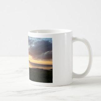 Taza del este de la puesta del sol de Thurso