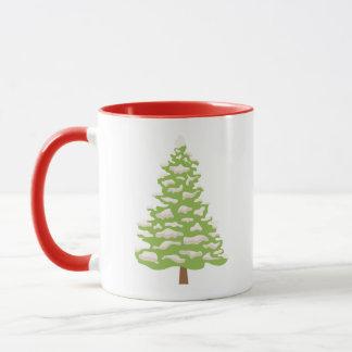 Taza del navidad con el árbol Nevado