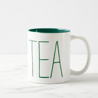 Taza del té en verde
