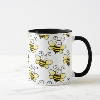 Taza El amarillo retro manosea el modelo de la abeja