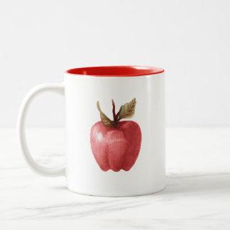 taza extraña de dibujo de la manzana