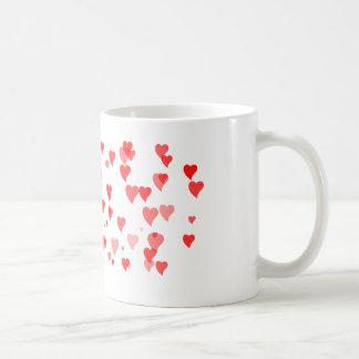 Taza minúscula dulce del amor de los corazones