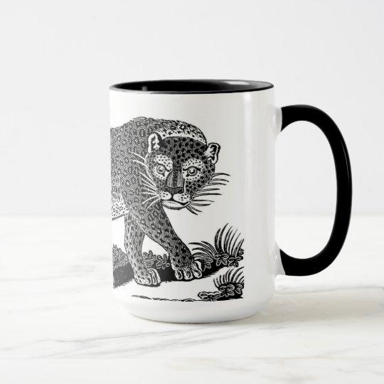 Taza negra y blanca de la taza del leopardo del