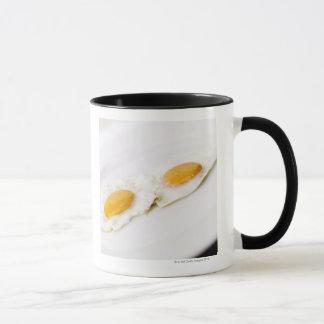 Taza Primer de dos huevos fritos