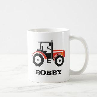 Taza roja del tractor con nombre