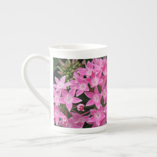 Taza rosada de las flores de J Spoelstra