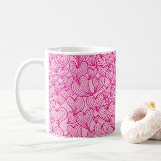 Taza rosada del modelo de los corazones del