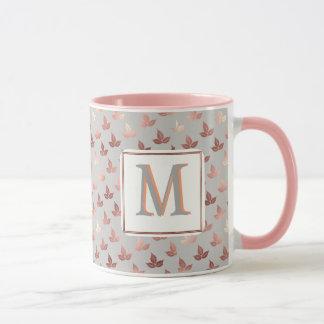 taza rosada gris gris de oro de la hoja del