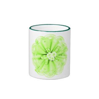 Taza verde de la decoración
