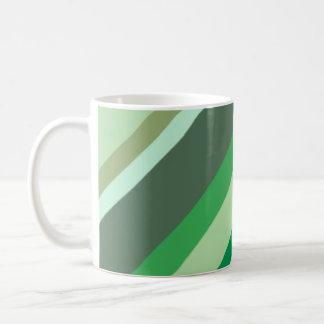 Taza verde de las rayas
