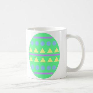 Taza verde del huevo