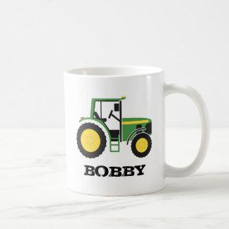 Taza verde del tractor con nombre