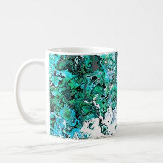Taza verde floral del diseñador del remolino