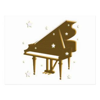 Teclado y estrellas de piano postal