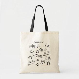 Teclear las notas musicales del tambor de la bolsa