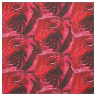 Tela agrupada de los rosas rojos
