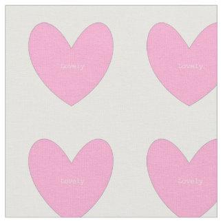 Tela de algodón con los corazones rosados
