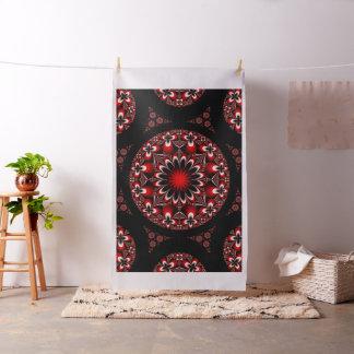 Tela roja y negra simétrica de las flores