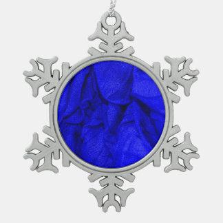 telas de la arruga, azules adorno de peltre en forma de copo de nieve