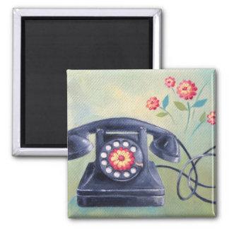 Teléfono del vintage y imán de las flores