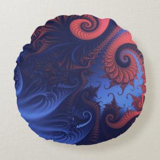Tentáculos coralinos del rojo y de los azules cojín redondo