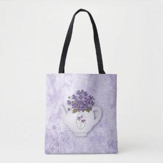Tetera violeta por todo la bolsa de asas de la