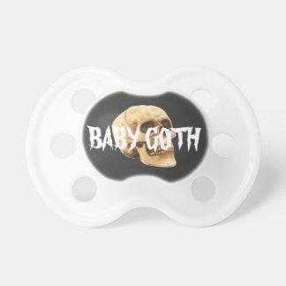 Texto y cráneo del gótico del bebé chupete