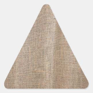 Textura de la arpillera con el hilo grueso y pegatina triangular