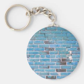 Textura de la pared de ladrillo del vintage del az llavero redondo tipo chapa
