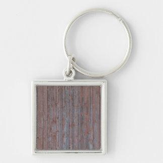 Textura de madera resistida vintage de la pared llavero cuadrado plateado