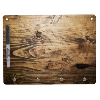 texturas de madera de madera de la naturaleza pizarra blanca con ganchos para llaves