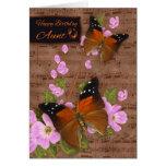 Tía, con la mariposa de la aleta en el flor rosado felicitaciones