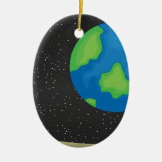 Tierra del planeta adorno navideño ovalado de cerámica
