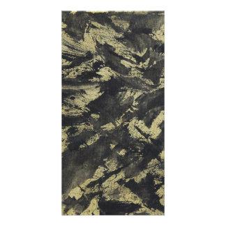 Tinta negra en fondo del oro tarjeta