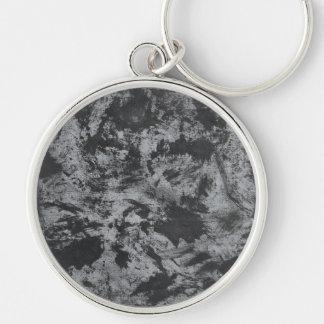 Tinta negra en fondo gris llavero redondo plateado