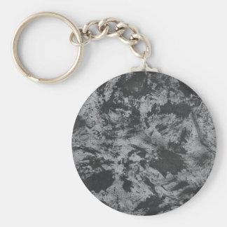 Tinta negra en fondo gris llavero redondo tipo chapa