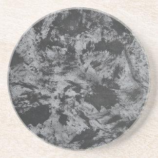 Tinta negra en fondo gris posavasos de arenisca
