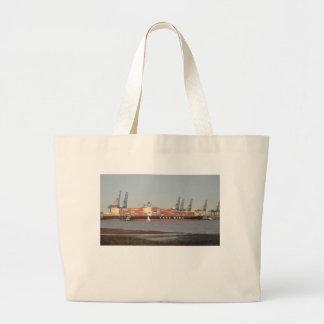 Tirones que ayudan a la nave bolsas lienzo