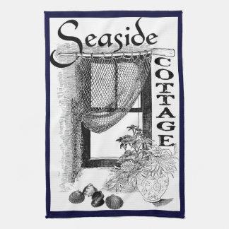 toalla de cocina de la ventana de la cabaña de la