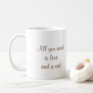 Todo lo que usted necesita es amor y un gato taza de café