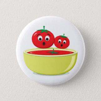 Tomate que cae en el botón de la comida de la sopa