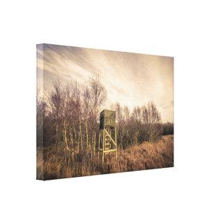 Torre del puesto de observación de la caza en impresión en lienzo