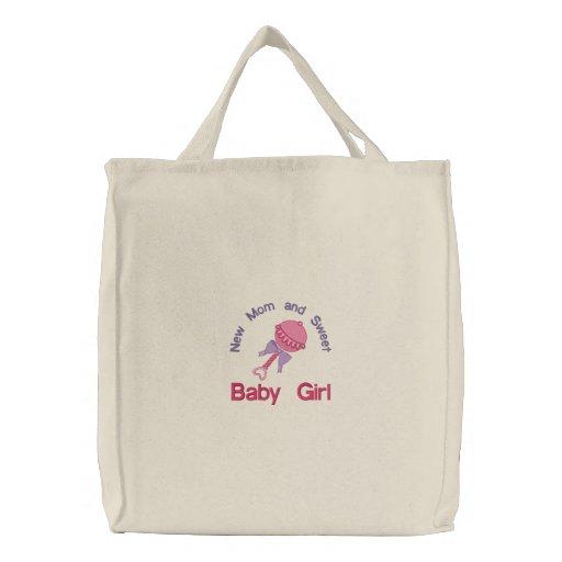 Traqueteo del bebé - rosa bolsas bordadas