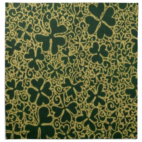 Tréboles afiligranados del oro servilleta imprimida