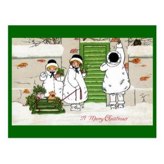 Tres chicas y cerdos en navidad del vintage del tr