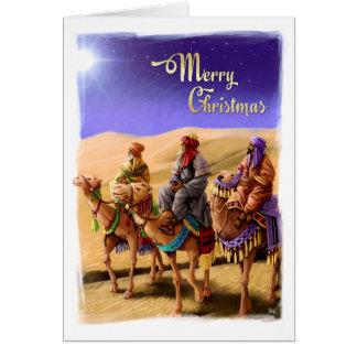 Tres hombres sabios que pintan tarjetas de Navidad