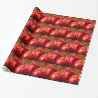 Tres manzanas rojas papel de regalo